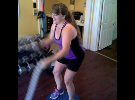 Christine working out with the rope and bosu.